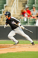 Hirotoshi Onaka (29) of the Hickory Crawdads starts down the first base line after laying down a bunt against the Kannapolis Intimidators at CMC-Northeast Stadium on July 28, 2013 in Kannapolis, North Carolina.  The Crawdads defeated the Intimidators 6-1.  (Brian Westerholt/Four Seam Images)
