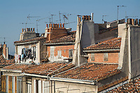 Traditional red roofs in the La Plaine district of Marseille, France.