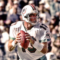 Dan Marino drops to pass during the final game of the legendary quarterback's career, a 62 to 7 Playoff loss by his Miami Dolphins tot he Jacksonville Jaguars in Alltell Stadium, Jacksonville, FL, January 15, 2000. (Photo by Brian Cleary/www.bcpix.com)