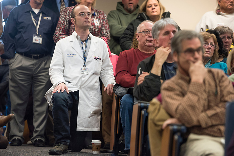 UNITED STATES - MARCH 16: Dr. Ryan McCarthy listens to Sen. Joe Manchin, D-W.Va., conduct a town hall meeting at the WVU Robert C. Byrd Health Sciences Center in Martinsburg, W.Va., March 16, 2017. Much of the discussion was regarding the American Health Care Act, the Republican's plan to repeal and replace the ACA. (Photo By Tom Williams/CQ Roll Call)