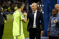 Real Madrid Manager Zinedine Zidane consoles Gianluigi Buffon of Juventus after the UEFA Champions League Final match between Juventus and Real Madrid at the Principality Stadium on June 3rd 2017 in Cardiff, Wales. <br /> <br /> Foto Daniel Chesterton / Panoramic / Insidefoto