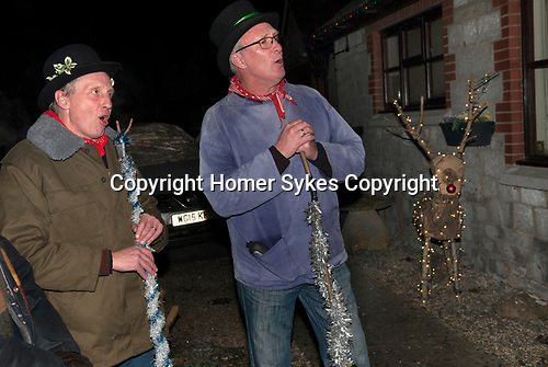 "Drayton Somerset, traditional house visiting Wassailers who travel around the village on old New Years Eve, January 5th, singing a traditional wassailing song, and bidding the house holders ""..........."", before being invited in for refreshment.  UK.  2017"