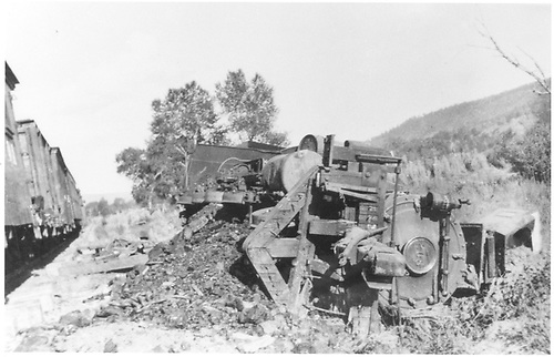 Engine #208 lying on its side.<br /> D&amp;RG  near Carracas, CO