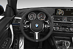 Car pictures of steering wheel view of a 2015 BMW 2 Series 228i 2 Door Convertible Steering Wheel