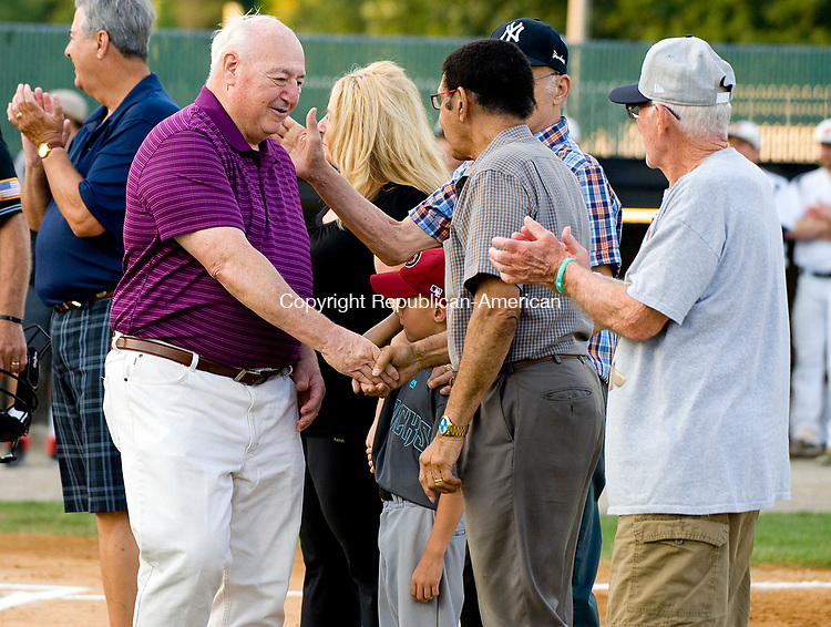 WATERBURY, CT-080317JS07-- Former Stan Musial players, including Jim Harris, left, were introduced prior to the Watertown Blaze game against the Bourne Mariners of Cape Cod, in the Stan Musial East Coast World Series Thursday at Municipal Stadium in Waterbury. <br /> Jim Shannon Republican-American