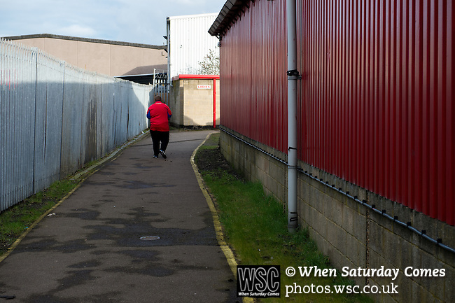 Dagenham and Redbridge 1 Burton Albion 3, 21/02/2015. Victoria Road, League Two. A Dagenham supporter has seen enough for the day. Burton Albion moved to the top of League Two following a hard-fought win over Dagenham & Redbridge played in-front of 1,718 supporters. Photo by Simon Gill.