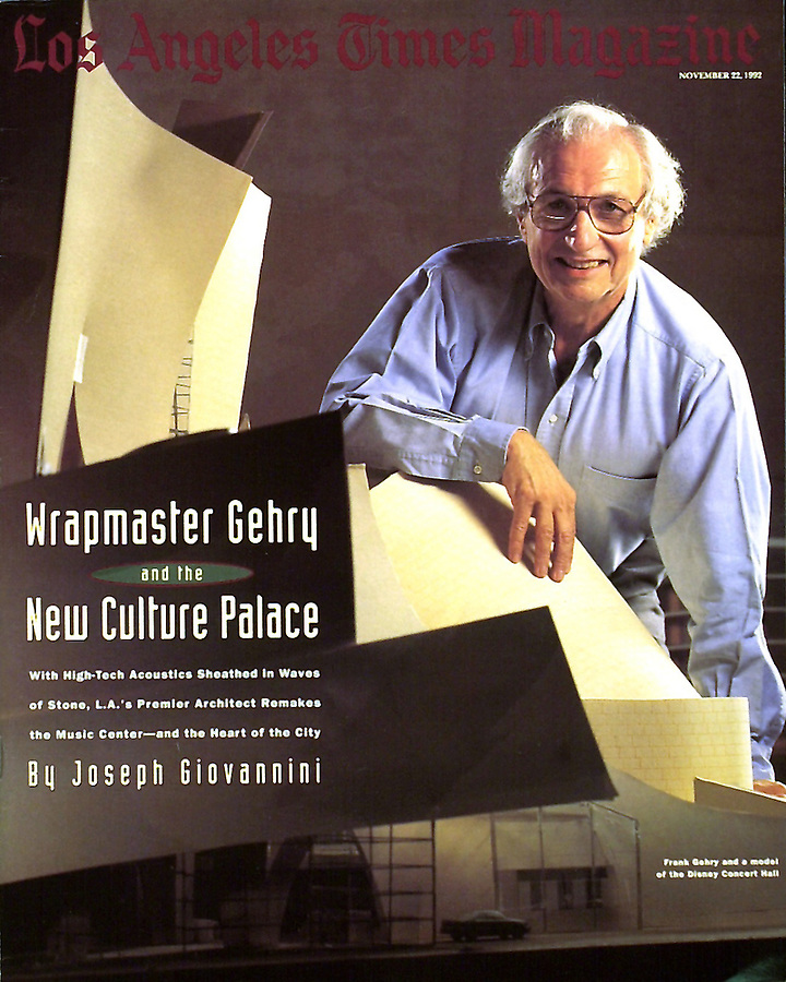 Dean Gehry and his original architectural model of poster board and scotch tape for the Disney Music Hall in Los Angeles. Once the curved walls were envisioned he created a fabrication process for making curved concrete walls. One is behind him in this portrait in his Santa Monica, CA studio for the Los Angeles Times Sunday Magazine. Mendenhall was the sole LA Times photographer assigned to the magazine that year. This was done in his Santa Monica studio without art direction. The Photo Editor was Lisa Thackaberry.