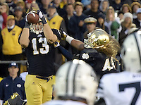 Linebacker Danny Spond (13) picks off a BYU pass, sealing the 17-14 win for Notre Dame.