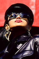 Chinese model beauty with black leather clothes, hat and glasses.