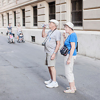Tourists enjoy their vacation in Rome.