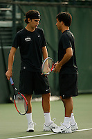 26 January 2006: Stanford's Blake Muller talks with partner Jon Wong during the Cardinal's 6-1 win over Hawaii at the Taube Family Tennis Stadium in Stanford, CA.