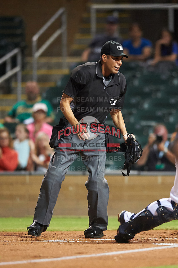 Umpire Gabe Morales keeps his eye on the play to make a call during an Arizona Fall League game between the Peoria Javelinas and Salt River Rafters on October 11, 2016 at Salt River Fields at Talking Stick in Scottsdale, Arizona.  The game ended in a 7-7 tie after eleven innings.  (Mike Janes/Four Seam Images)