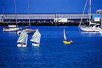 Young chidren sailing in Los Cristianas harbour. Los Cristianos.Tenerife. Canary Islands, Spain.