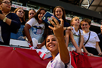 HARRISON, NJ - SEPTEMBER 29: Sydney Leroux #2 of the Orlando Pride takes a selfie with fans after the match during a game between Orlando Pride and Sky Blue FC at Red Bull Arena on September 29, 2019 in Harrison, New Jersey.