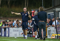 Colchester United Manager John McGreal points 2 fingers at Wycombe Wanderers Manager Gareth Ainsworth during the Sky Bet League 2 match between Wycombe Wanderers and Colchester United at Adams Park, High Wycombe, England on 27 August 2016. Photo by Andy Rowland.