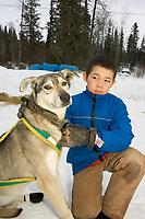 Anvik Boy Holds A.Burmeisters Dog @ Chkpt 2005 Iditarod *Taos*