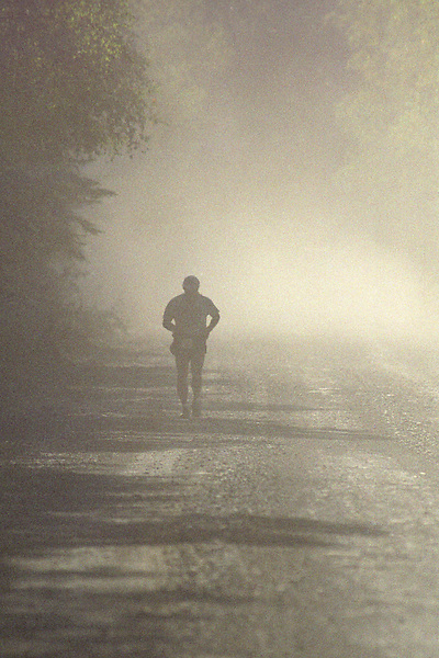 Rick Rochelle suffers through thick dust on Resurrection Pass Road during the 2004 Resurrection Pass Trail 100-Miler ultramarathon race. Most of the course is run across the trail in the Kenai Mountains and Chugach National Forest between Cooper Landing and Hope, Alaska.