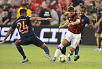 Corentin Tolisso (24, left) and Renato Sanches (35, right) of Bayern Munich double-team Fabio Borini (11) of Milan during their International Champions Cup match on July 23, 2019 at Children's Mercy Park in Kansas City, KS.<br /> Tim VIZER/AFP