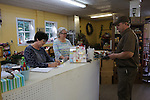 Marlene Feltner and Deina Melton accepting a package from the UPS postman at the flower shop in Hyden, Ky., on Thursday, October, 10, 2013. Photo by Rachel Walker