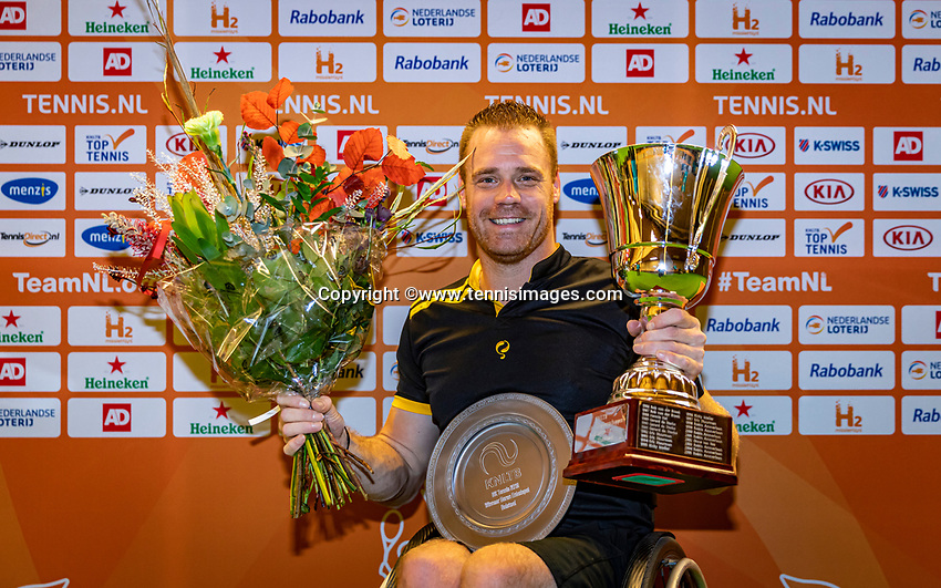 Alphen aan den Rijn, Netherlands, December 22, 2019, TV Nieuwe Sloot,  NK Tennis, Wheelchair men single final: Winner Maikel Scheffers (NED) with the trophy<br /> Photo: www.tennisimages.com/Henk Koster