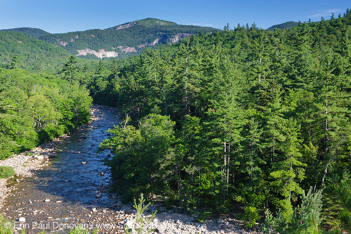 Swift River during the summer months in the White Mountains, New Hampshire USA. Table Mountain is off in the distance. The area under the cliff is part of the proposed Northeast Swift Timber Project