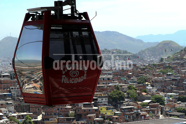 The cable car at the favela complex of Alemao, Rio de Janeiro, a revolutionary transportation that allowed the integration of slums with the rest of the city. For dwellers of the slums the cable car is the fastes and secure way to go downtown, while UPP (Pacifying Police Unit) keeps the system safe.