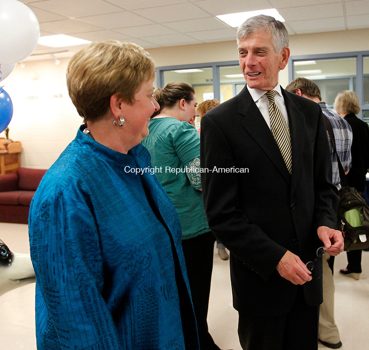 Torrington, CT-04 April 2012-050412CM09-  Judith DiLaurenzio (left) Interim Campus Director at Uconn Torrington, shares a laugh with new director of the branch, Dr. Barry Feldman  before the start of a reception for graduates Friday night at the Uconn Torrington campus in Torrington.  A reception was held for the graduates at the Hogan Lecture Hall.  They will be receiving their degrees during commencement at Uconn Storrs.      Christopher Massa Republican-American