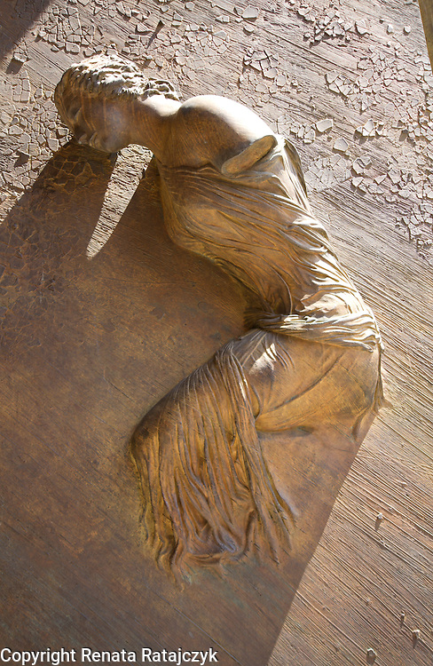 Sculpture of a woman on the door of Basilica of St. Mary of the Angels and the Martyrs, Rome, Italy