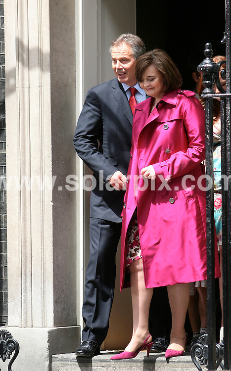 **ALL ROUND PICTURES FROM SOLARPIX.COM**.**SYNDICATION RIGHTS FOR SPAIN, PORTUGAL & DUBAI (U.A.E) ONLY**.The Blairs leaving 10 Downing Street for the last time.JOB REF:  4162    NLA    DATE: 27.06.07.*UNDER NO CIRCUMSTANCES IS THIS IMAGE TO BE REPRODUCED FOR ANY ONLINE EDITION WITHOUT PRIOR PERMISSION*