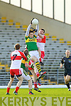 David Moran Kerry in action against Mark Lynch Derry in round Two of the National Football league at Fitzgerald Stadium, Killarney on Sunday the 9th of February.
