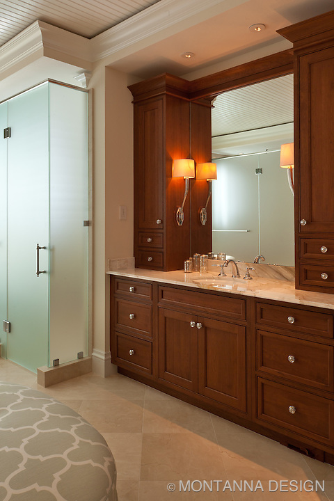 Master Bath has rich stained cabinets in a finish that echoes the wood floors on the level<br />