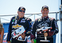 Sep 4, 2016; Clermont, IN, USA; NHRA funny car driver John Force (left) and Tim Wilkerson during qualifying for the US Nationals at Lucas Oil Raceway. Mandatory Credit: Mark J. Rebilas-USA TODAY Sports