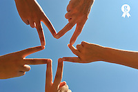 Five hands drawing a star shape, close-up (Licence this image exclusively with Getty: http://www.gettyimages.com/detail/91875433 )