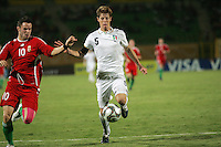 Italy's Michelangelo Albertazzi (5) races Hungary's Adam Dudas (10) to the ball during the FIFA Under 20 World Cup Quarter-final match at the Mubarak Stadium  in Suez, Egypt, on October 09, 2009. Hungary won 2-3 in overtime.
