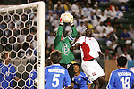 7 June 2007: El Salvador goalkeeper Juan Gomez (in green) claims the ball against the challenge of Trinidad's Keyeno Thomas (5). The National Team of El Salvador defeated the National Team of Trinidad & Tobago 2-1 at the Home Depot Center in Carson, California in a first round game in the CONCACAF Gold Cup.