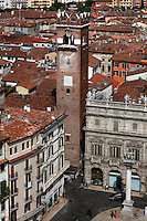 View from the Lamberti tower of the Gardello tower and Palazzo Maffei (right), Piazza delle Erbe (Square of Herbs), Verona, Italy. The Gardello Tower was built in 1370 in brick by Cansignorio della Scala. The apex was added in 1626. The baroque Palazzo Maffei, was built in 1668 by Rolando Maffei. From the balustrade the Greek gods Zeus, Aphrodite, Apollo, Athena, Hermes and Hercules are overlooking the market life of the square. On the bottom right of the picture, the lion of Saint Mark at the top of a sixteenth century marble column can be seen. Picture by Manuel Cohen.