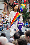 © Joel Goodman - 07973 332324 . 24 August 2013 . Manchester , UK . Giant Jesus with rainbow flag with gay Christian group . 2013 Gay Pride Parade through Manchester City Centre . This year's theme is 1980s . Photo credit : Joel Goodman