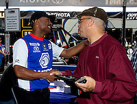 May 17, 2014; Commerce, GA, USA; A fan with NHRA top fuel dragster Antron Brown during qualifying for the Southern Nationals at Atlanta Dragway. Mandatory Credit: Mark J. Rebilas-USA TODAY Sports