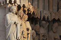 Statues of local saints and angels (right-left: St Honore, an angel, St Acheul, St Ache, an angel, St Ulphe) on the left embrasure of the St Firmin Portal on the Western facade of the Basilique Cathedrale Notre-Dame d'Amiens or Cathedral Basilica of Our Lady of Amiens, built 1220-70 in Gothic style, Amiens, Picardy, France. St Firmin, 272-303 AD, was the first bishop of Amiens. Amiens Cathedral was listed as a UNESCO World Heritage Site in 1981. Picture by Manuel Cohen