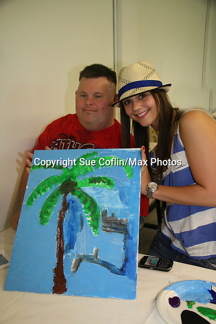 As The World Turns' Alexandra Chando paints with Troy as she donates her time at the 12th Annual SoapFest - Painting Party to benefit Marco Island YMCA, theatre program & Art League of Marco Island on May 15, 20010 on Marco Island, FLA. (Photo by Sue Coflin/Max Photos)