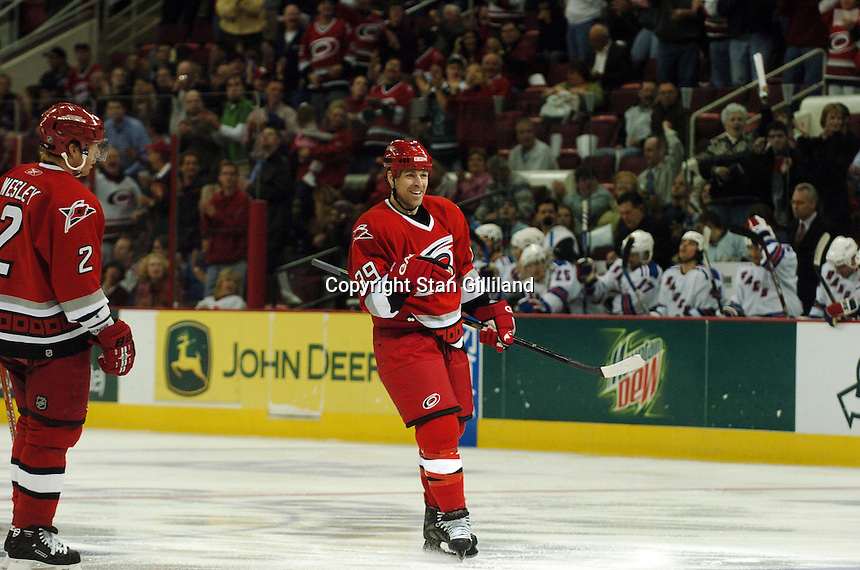 Carolina Hurricanes' Doug Weight celebrates his first goal of the night against the New York Rangers as teammate Glen Wesley approaches, left, Tuesday, March 14, 2006 at the RBC Center in Raleigh, NC. Carolina won 5-3.