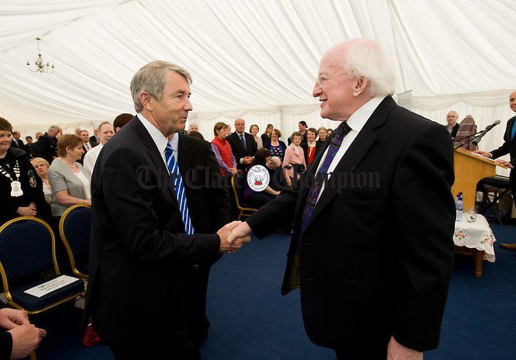 President Michael D Higgins is greeted by Michael Lowry, TD. as he arrives in the marquee for the official opening of the Watermans Lodge day Care and Respite centre at Ballina. Photograph by John Kelly.