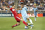 09 June 2011: Kansas City's Omar Bravo (MEX) (99) and Chicago's Bratislav Ristic (SRB) (left). Sporting Kansas City played the Chicago Fire to a 0-0 tie in the inaugural game at LIVESTRONG Sporting Park in Kansas City, Kansas in a 2011 regular season Major League Soccer game.