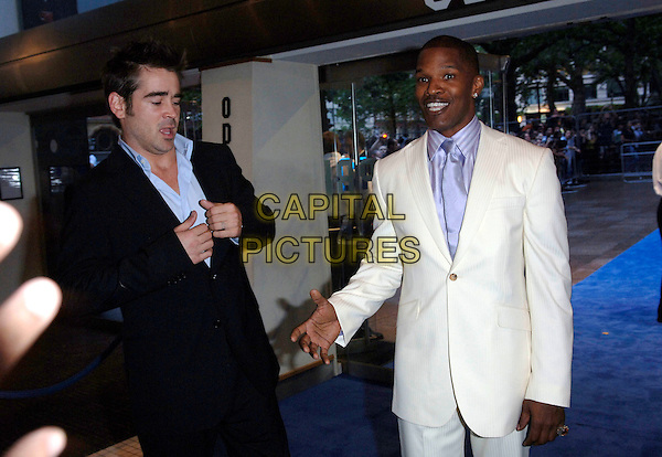 "COLIN FARELL & JAMIE FOXX.European film premiere""Miami Vice"".Odeon cinema Leicester Square.27th July 2006 in London, England.Ref: FIN.half length white suit black funny face.www.capitalpictures.com.sales@capitalpictures.com.©Steve Finn/Capital Pictures."