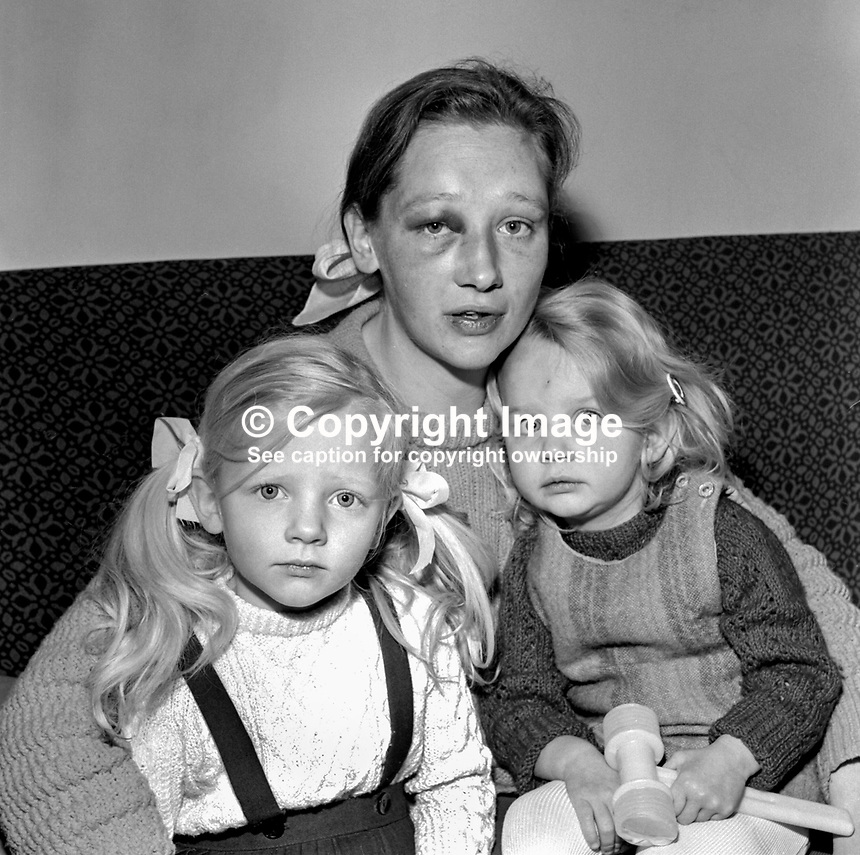Anita Currie, wife of SDLP MP Austin Currie, with her 2 children, following an attack in her Dungannon home by two armed men. She suffered a severe blow to the eye and kicked in the lower part of her body while on the ground after fainting. The intruders said they were after her husband who was a speaking engagement in Cork. 197211160724b.<br />