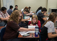 NWA Democrat-Gazette/ANTHONY REYES &bull; @NWATONYR<br /> Christine Morledge, helps students in her physics class, Monday, Sept. 14, 2015 at Har-Ber High School in Springdale. The high school has seen a rising student population with numbers exceeding 2,100 students. The school has added a number of teaching positions.