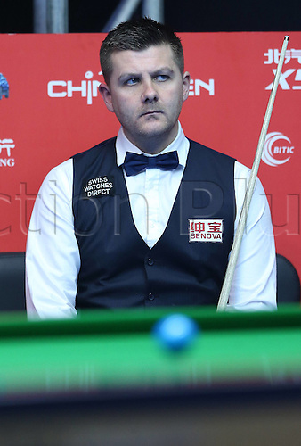 29.03.2016. Beijing, China,  Ryan Day of Britain reacts during the match against Dechawat Poomjaeng of Thailand at the 2016 World Snooker China Open in Beijing, China, March 29, 2016.