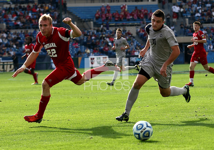 HOOVER, AL - DECEMBER 09, 2012: Caleb Konstanski (22) of Indiana University and Brandon Allen (10) of Georgetown University go for a loose ball during the NCAA 2012 Men's College Cup championship, at Regions Park, in Hoover , AL, on Sunday, December 09, 2012.