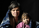 "THIS PHOTO IS AVAILABLE AS A PRINT OR FOR PERSONAL USE. CLICK ON ""ADD TO CART"" TO SEE PRICING OPTIONS.   Arbanac Sofija and her 3-year old daughter Caka huddle under a blanket - provided by Church World Service - inside their meager home in an illegal Roma settlement in Belgrade, Serbia, in February 2012. The poor family has been told it will be evicted by city officials in March 2012 to make way for new high-rise office buildings. Roma in Belgrade, often living in miserable conditions, have faced increasing evictions in order to make way for high-rise developments."