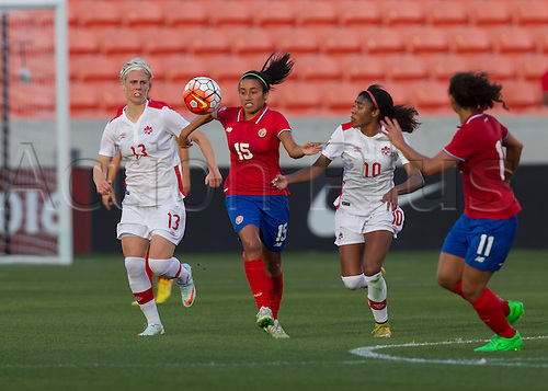 19.02.2016. Houston, TX, USA.  Canada Midfielder Sophie Schmidt (13)  and Costa Rica Midfielder Cristin Granados (15) during the Women's Olympic semi-final qualifying game between Canada and Costa Rica at BBVA Compass Stadium in Houston, Texas.
